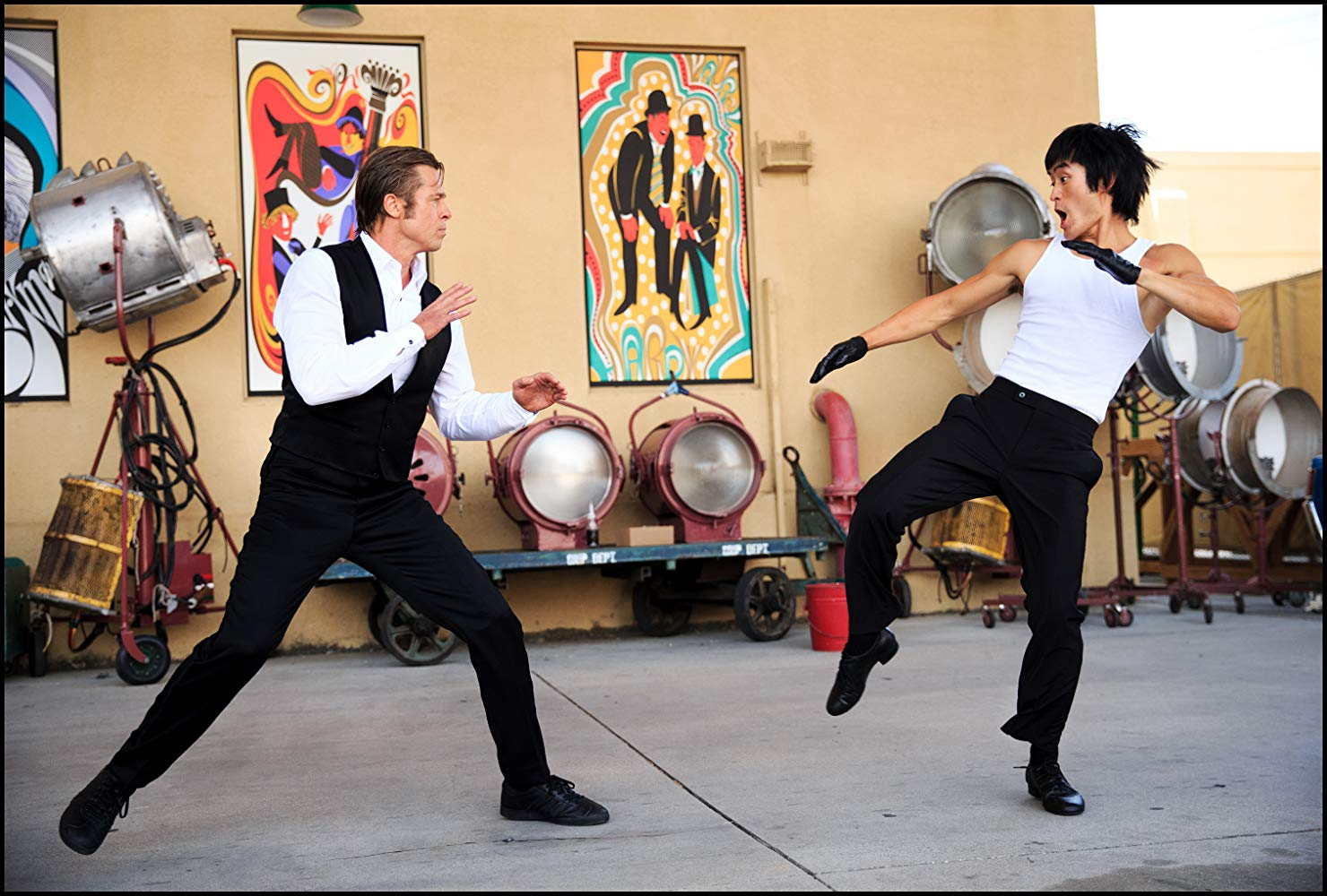 Cliff Booth (Brad Pitt) faces Bruce Lee (Mike Moh) in Once Upon a Time in Hollywood