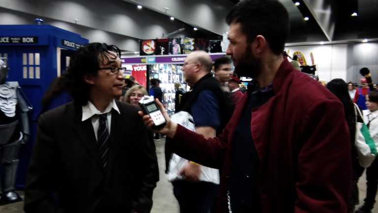 Tom Denham (right) speaks with Phillip, a member of the Doctor Who Fan Club of Australia, at OZ Comic-Con