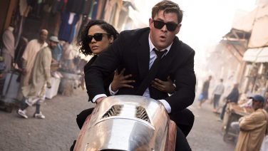 "Tessa Thompson and CHris Hemsworth in a promotional still for ""Men in Black: International"""
