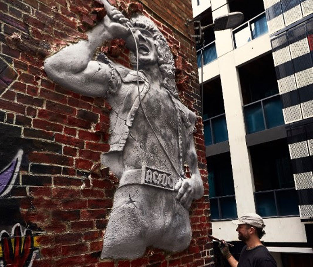 Mike Makatron at work on the Bon Scott installation on AC/DC Lane. Credit: Jay Hynes.