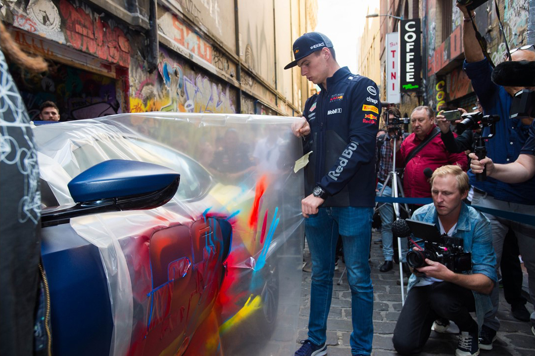 Max Verstappen reveals the street-art design on the Aston Martin. Credit: Supplied.