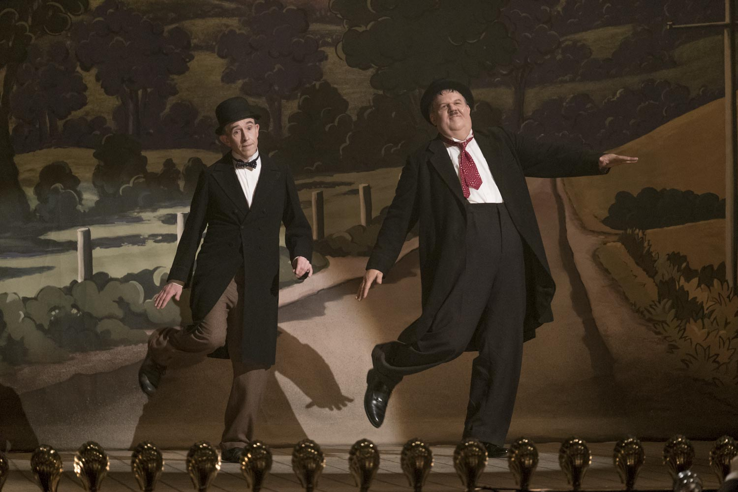 Stan Laurel (Steve Coogan, left) and Oliver Hardy (John C. Reilly) re-enact one of their famous routines in Stan & Ollie
