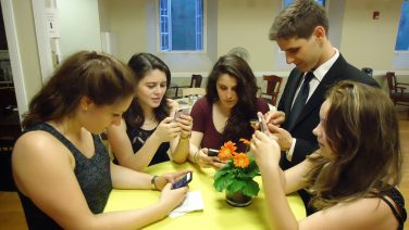 Young_people_texting_on_smartphones_using_thumbs-1.jpg