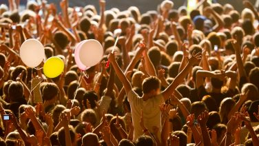 Yellow,Lighted,Arded,Crowd,At,A,Live,Concert,Of,A