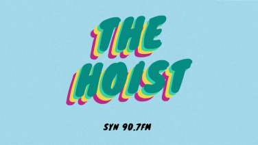 "red yellow and green text saying ""the hoist"" on a blue background"