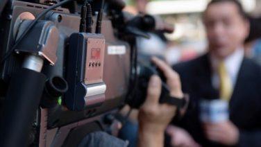 cameraman-filming-reporter.jpg