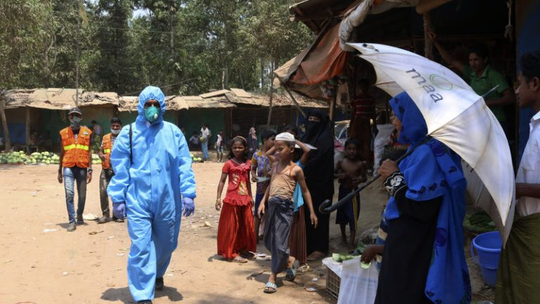 A health worker wearing personal protective equipment in the Kutupalong Rohingya refugee camp in Cox's Bazar, Bangladesh, last month. On Thursday, Bangladesh reported the area's first confirmed coronavirus infections.